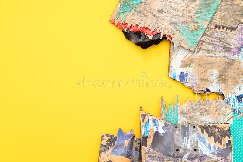 Broken colourful skateboard decks stacked on top of each other,. Skateboard recycling stock photos