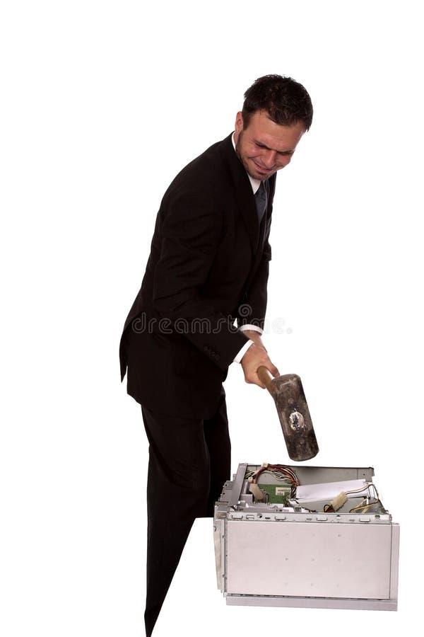 Broken computer 3. Young businessman destroying a computer with a sledge hammer stock photos