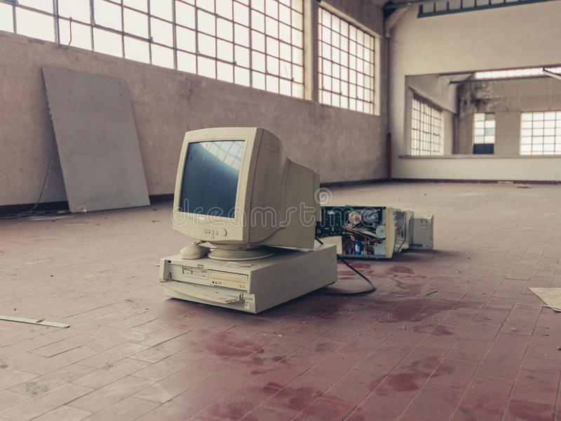 Broken computer abandoned stock image