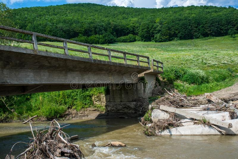 Broken concrete bridge after several heavy floods royalty free stock image