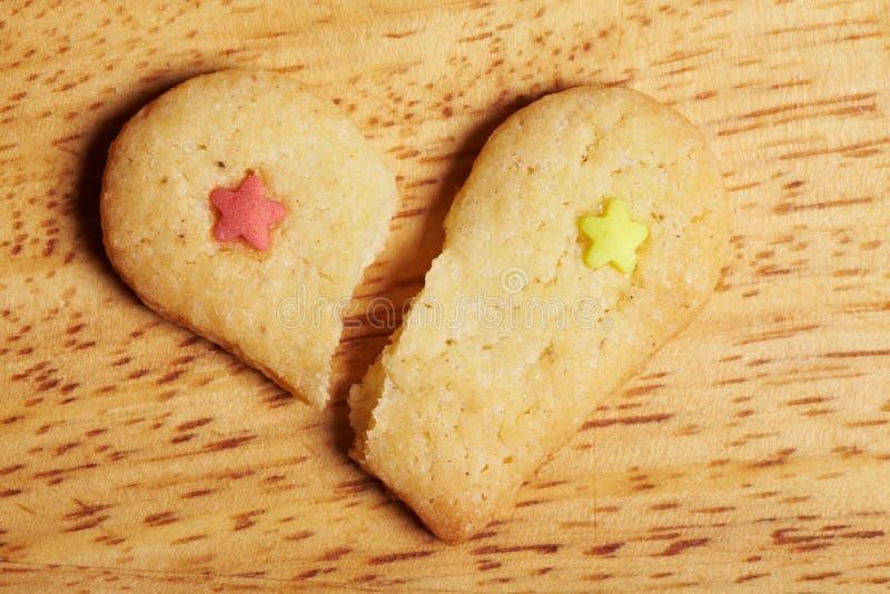 Broken cookie heart stock image