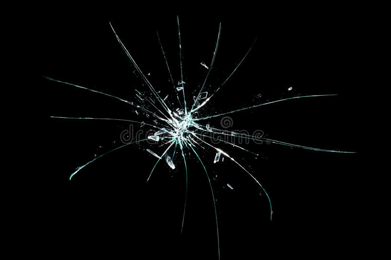 Broken cracked glass with hole over black background royalty free stock photos