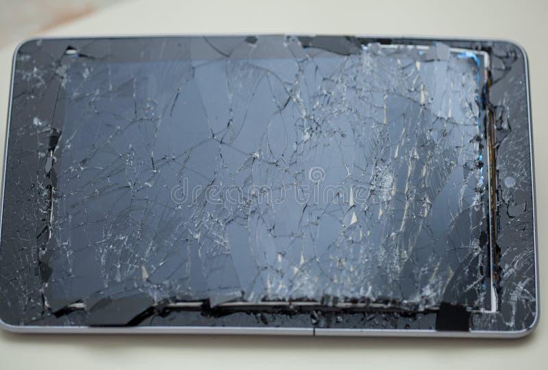 Broken, cracked tablet stock photos