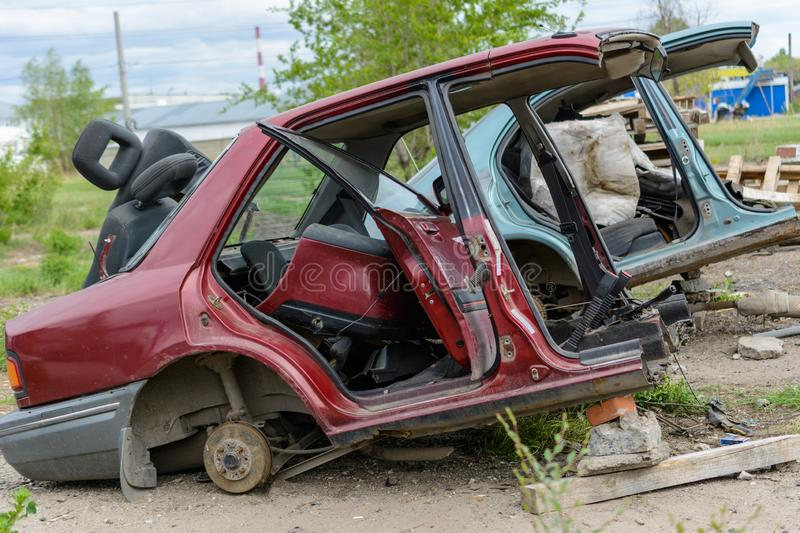 Broken, crumpled, dented car after the accident. Abandoned wrecked cars. Dump of wrecked cars. Broken auto after an accident royalty free stock images