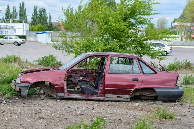 Broken, crumpled, dented car after the accident. Abandoned wrecked cars. Dump of wrecked cars. Broken auto after an accident royalty free stock image