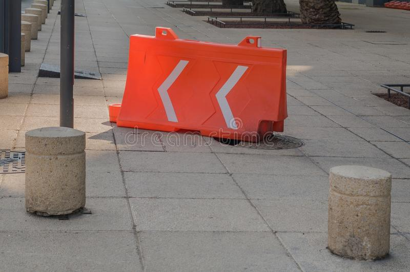Broken culvert covered with an orange plastic structure used in stock image