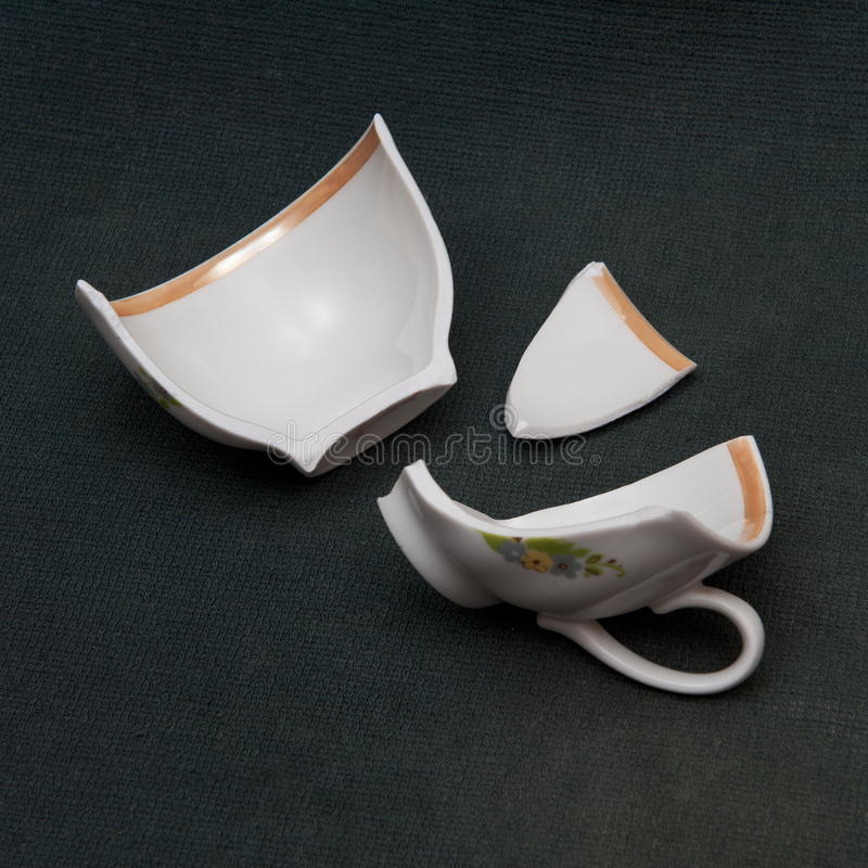 Broken cup royalty free stock photography