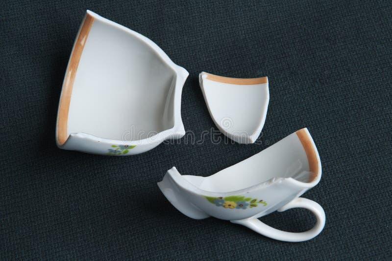 Broken cup stock image