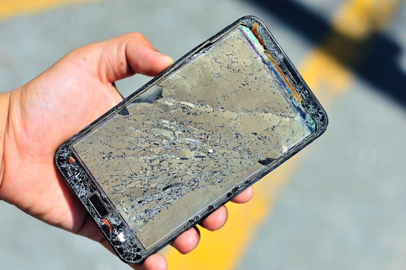 Broken damage mobile in sun light royalty free stock photos