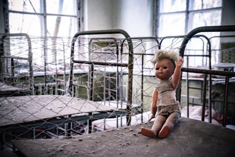 Broken doll in Kopachi kindergarten, Chernobyl zone royalty free stock images