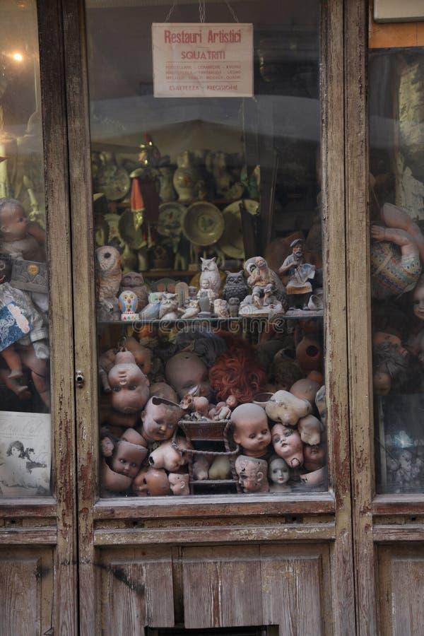 Broken dolls behind glass stock photo