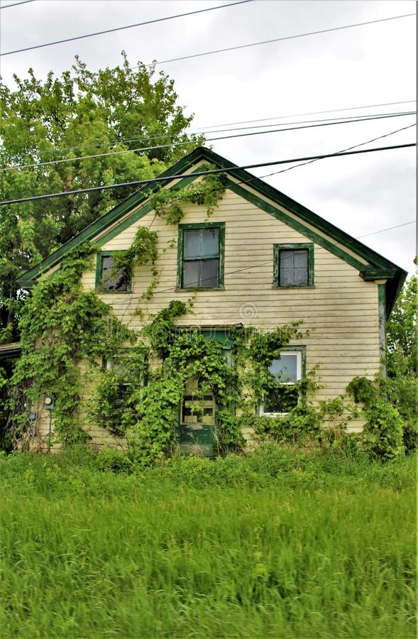 Abandoned old dilapidated wooden house in rural upstate Franklin County, New York, United States. Broken down abandoned old dilapidated wooden house located in royalty free stock photo