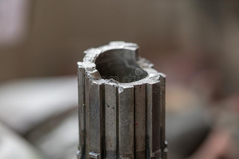 Broken down toothed hollow shaft. Mechanical or car part repair. royalty free stock photo