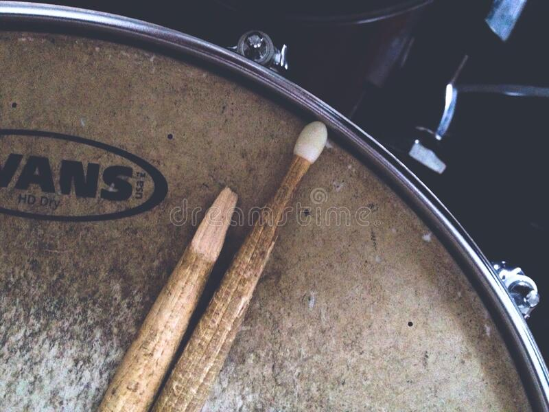 Broken drumstick on drum stock photography