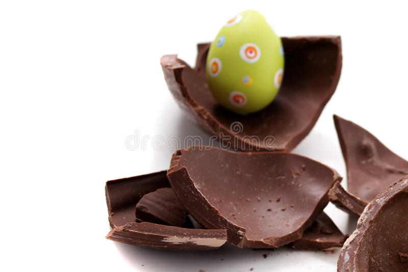 Broken Easter egg in pieces. On white background royalty free stock photos