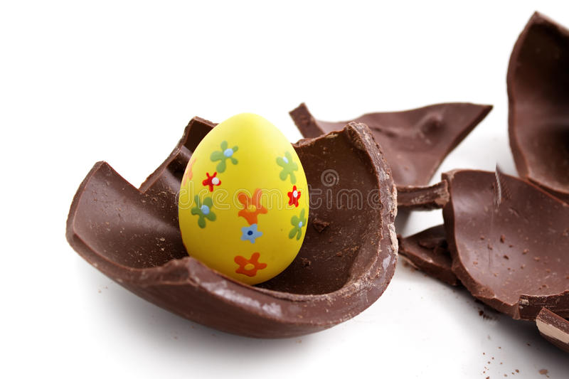 Broken Easter egg in pieces. On white background royalty free stock images