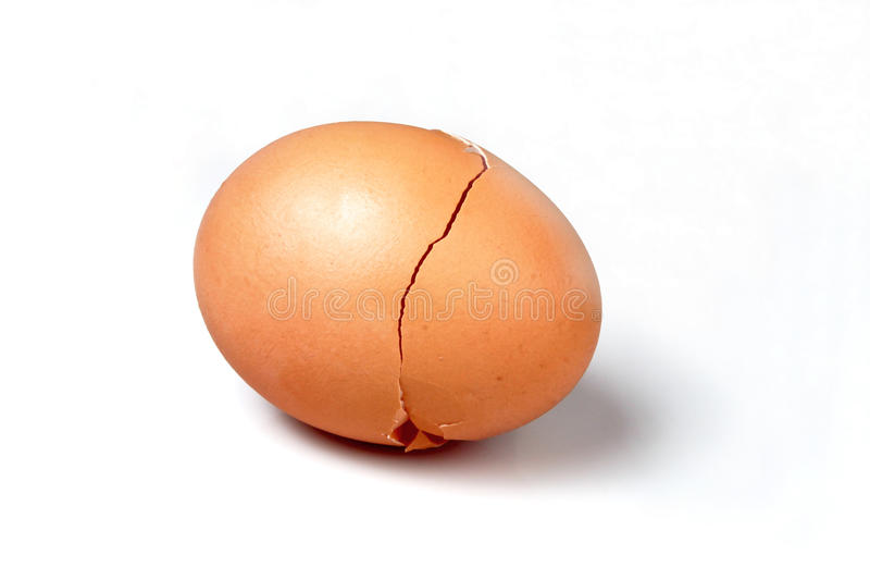 Broken egg with a crack. In white background (with clipping path stock photography