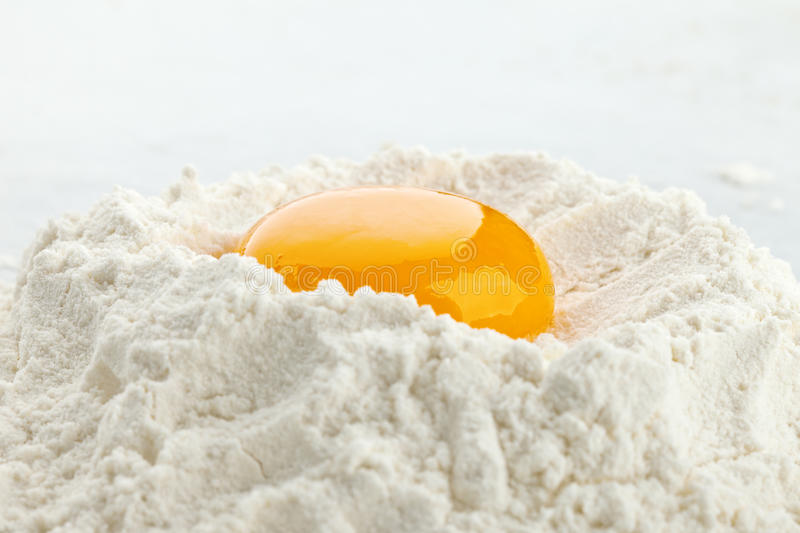Download Broken egg on flour stock photo. Image of dough, bake - 17712472