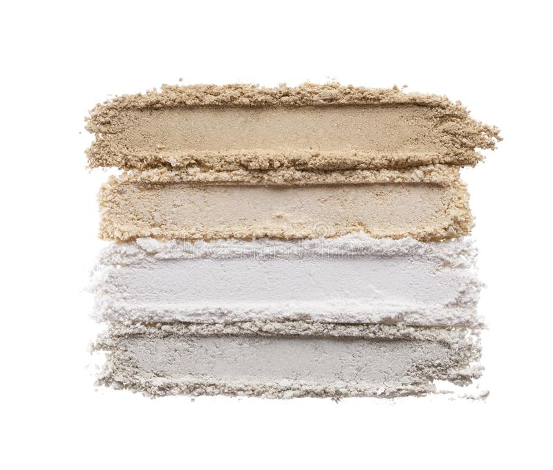 Broken eyeshadows in trendy shades. Isolated on white background stock images