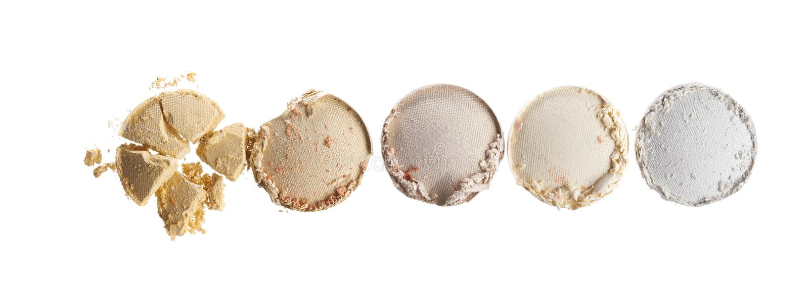 Broken eyeshadows in trendy shades. Isolated on white background royalty free stock photos