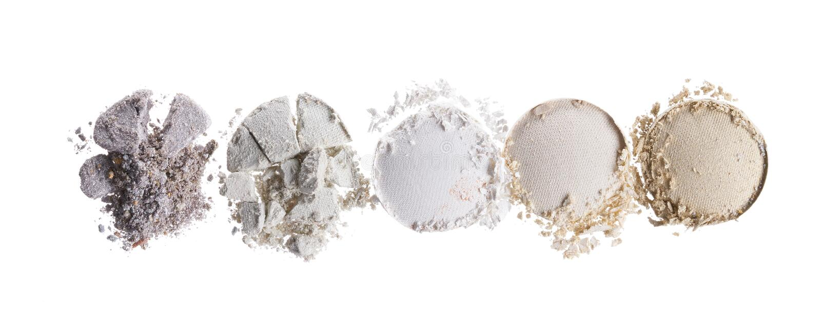 Broken eyeshadows in trendy shades. Isolated on white background stock photography
