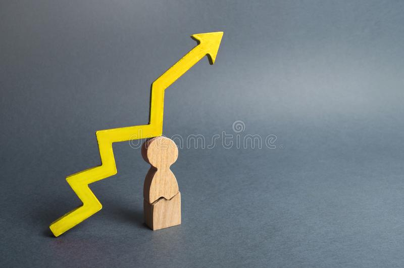 Broken figurine man and yellow arrow up. Body wearout from overwork. Increased risk to human health. Lack of sleep. High workload. Or tense situation at home stock photo