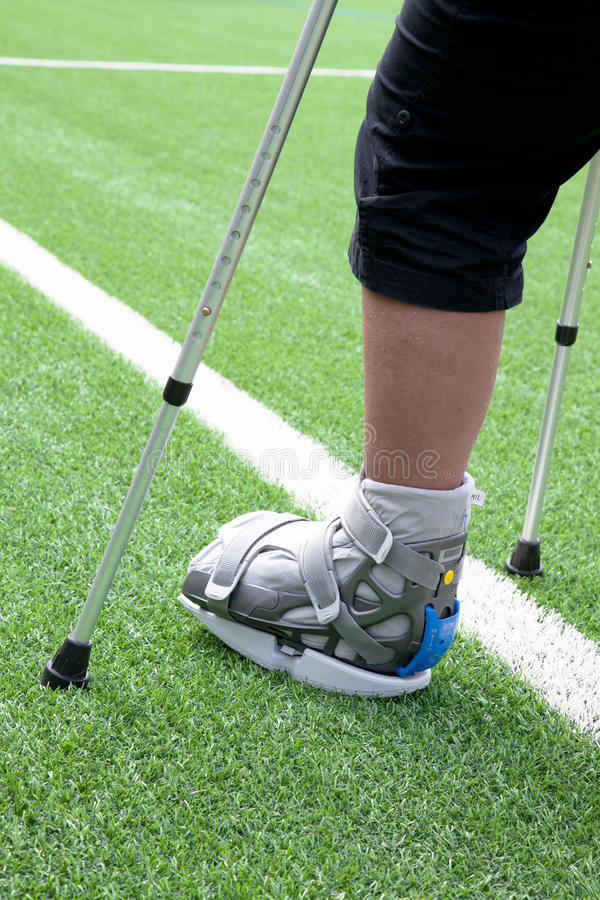 Broken Foot, Crutches - Sports Injury Royalty Free Stock Image