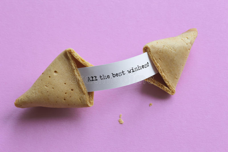 Broken fortune cookie showing a message stock photos