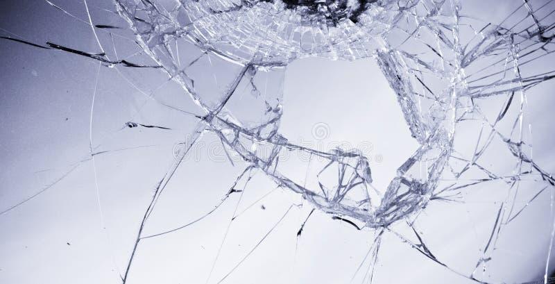 Broken glass. In clear blue tone