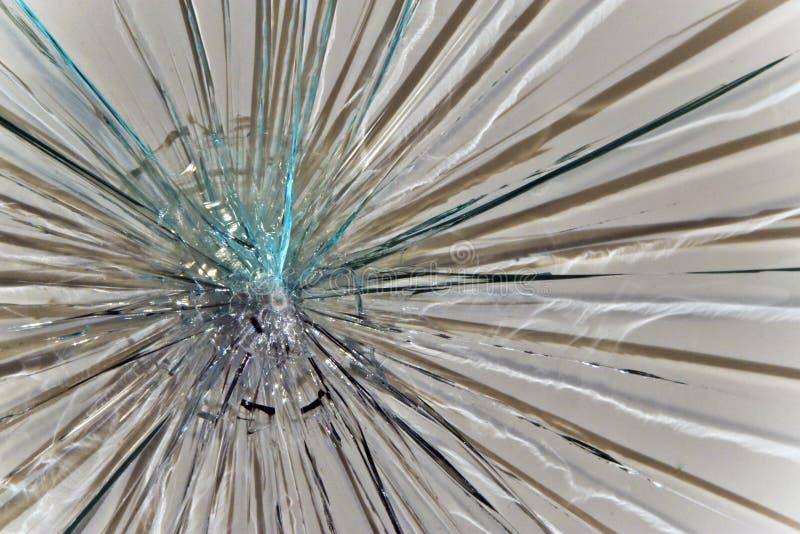 Broken Glass. Broken clear glass shattered closeup stock photo