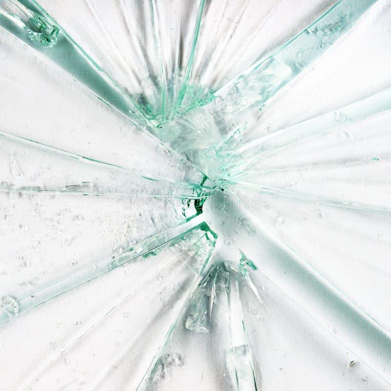 Broken glass. On white background royalty free stock photo