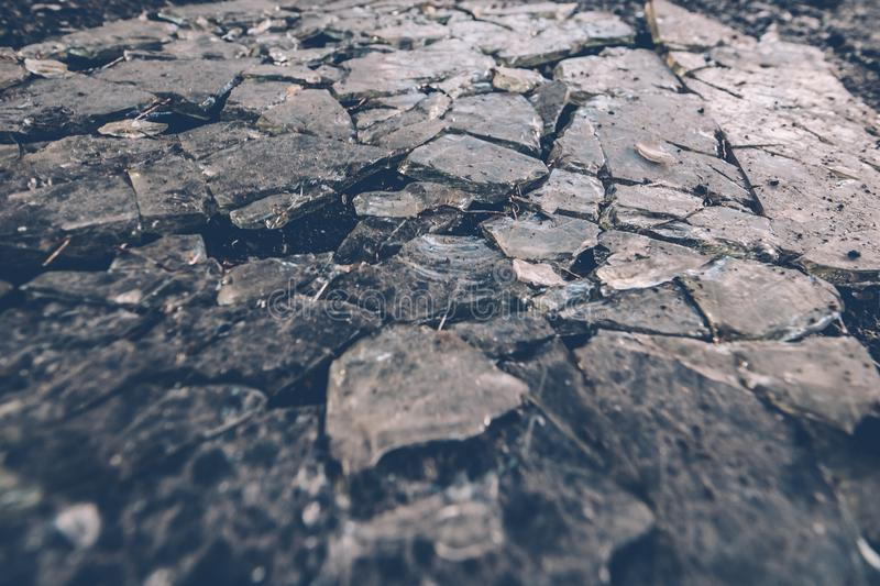 Broken glass background, shattered to splinters old glass surface royalty free stock photos