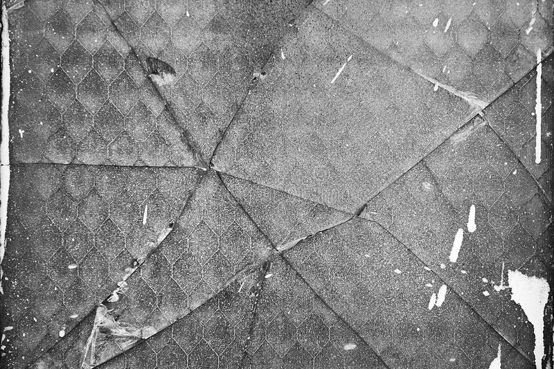 Broken glass background texture. Old dirty broken glass background texture with paint splatters royalty free stock photography
