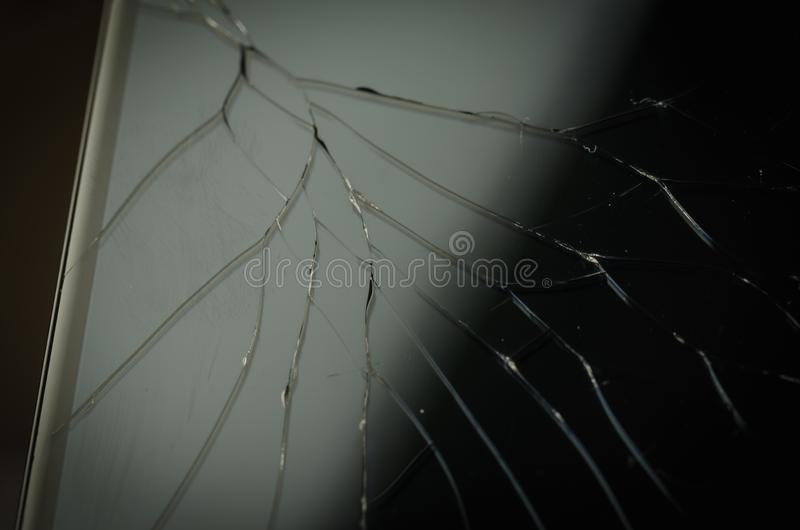 Broken glass on the black smartphone/broken glass on the black s. Martphone. Close up royalty free stock photo