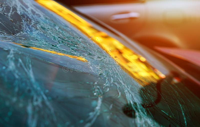Broken glass on a car with broken windshield after crash accident stock photos