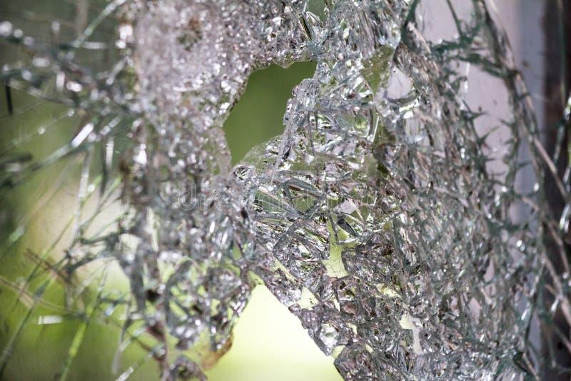Broken glass crack. On a light background stock images