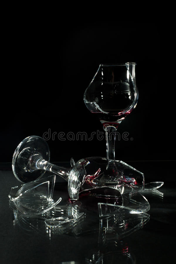 Broken Glass Cups With Reflection On A Glass Table Isolated On Black