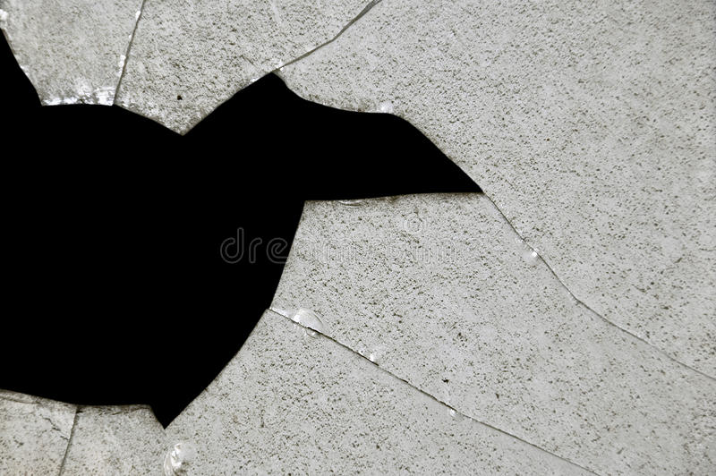 Broken glass fragments stock photos