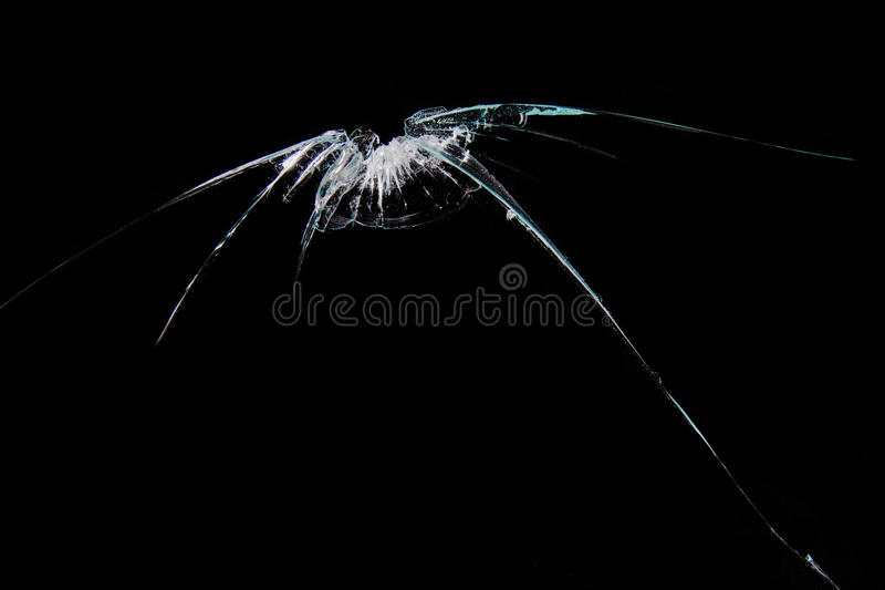 Broken glass. Isolated on black background royalty free stock photo