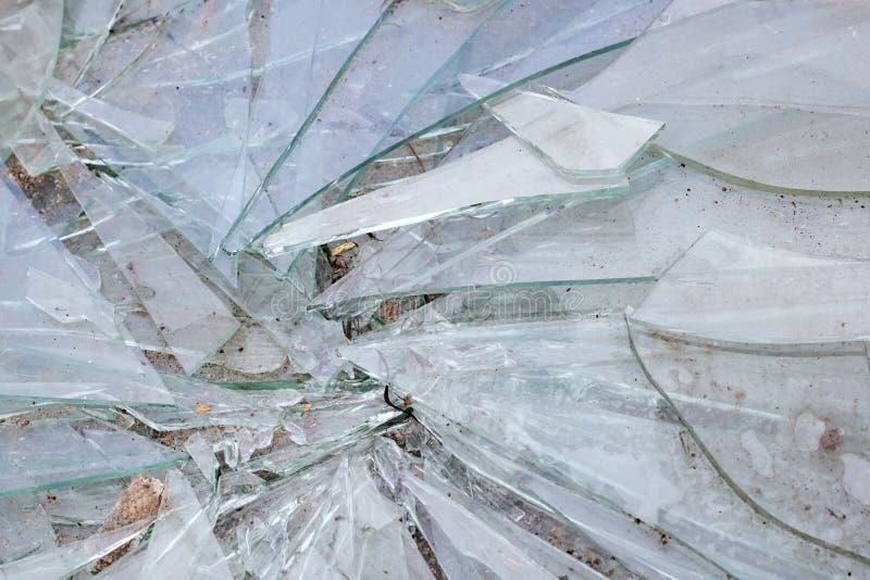 Broken glass shards closeup, texture or background stock photos