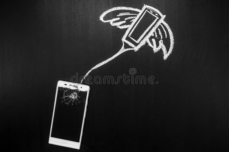 Broken glass of smartphone on the black background and its soul is flying away on the heaven written by chalk royalty free stock images