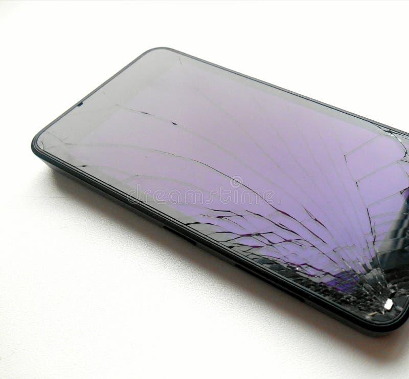 Broken glass smartphone. White isolated stock image