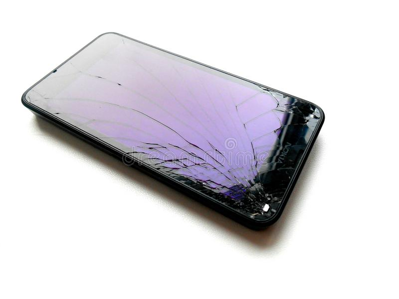 Broken glass smartphone. White isolated royalty free stock images