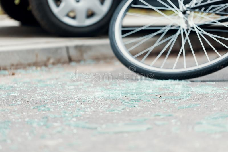 Broken glass on the street after a car accident with cyclist royalty free stock images