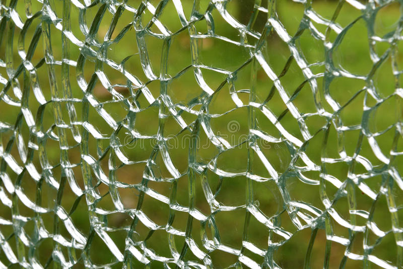 The broken glass. The texture of the broken explosion-proof glass royalty free stock image