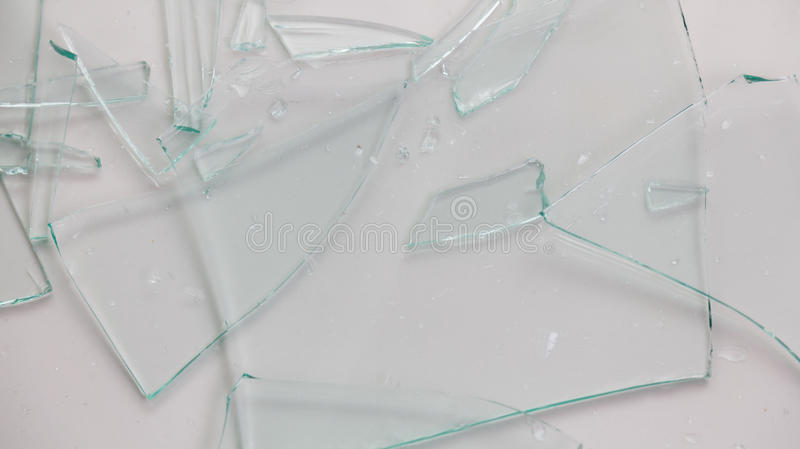 Broken glass. On white background stock photography
