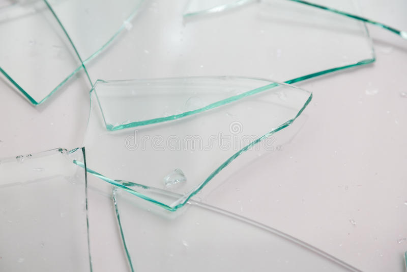 Broken glass. On white background stock image