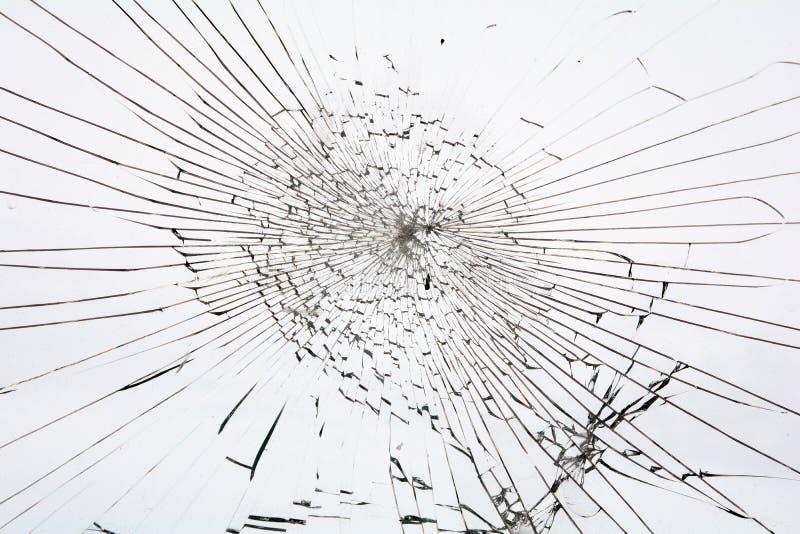 Broken glass white background. The Broken glass white background royalty free stock photos