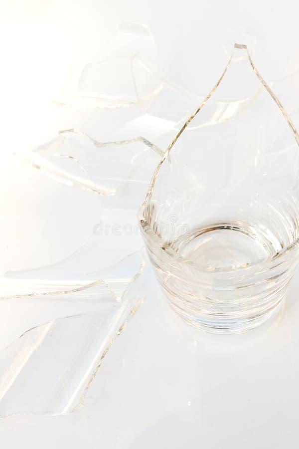 Broken glass on white background. Closeup broken glass on white background stock photos