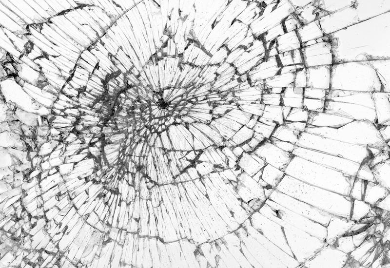 Broken glass, white background. Concept of violence royalty free stock photo